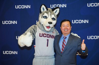 Jonathan the Husky and Provost Mun Choi at the 2015 UConn Spirit awards event held at the Student Union Ballroom on March 4, 2015. (Peter Morenus/UConn Photo)
